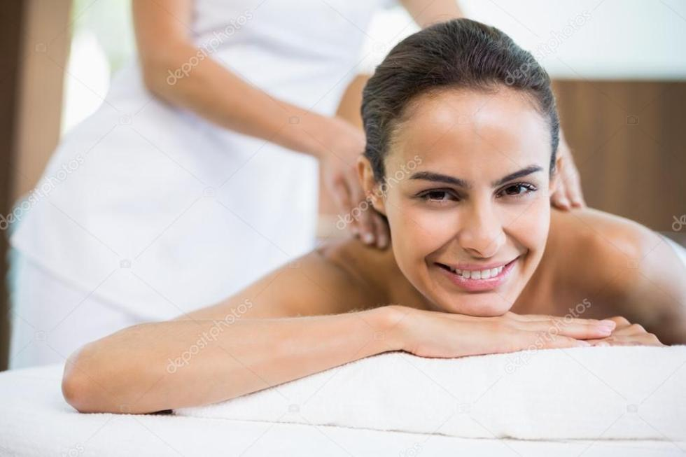 depositphotos_102609954-stock-photo-woman-smiling-while-receiving-massage